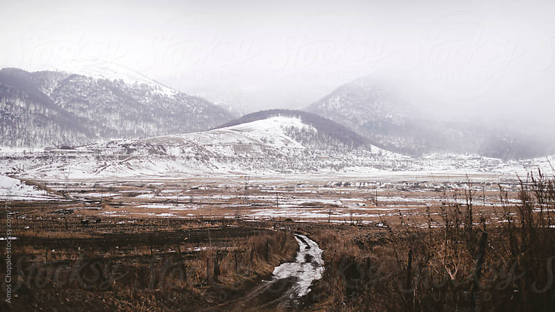 A dirt track leading out of an Armenian village.  by Amos Chapple for Stocksy United