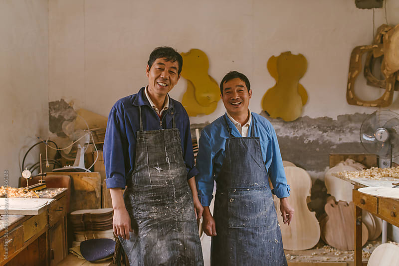 Violin makers at work by MaaHoo Studio for Stocksy United