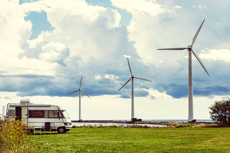 Camper in a meadow by wind turbines by Lior + Lone for Stocksy United