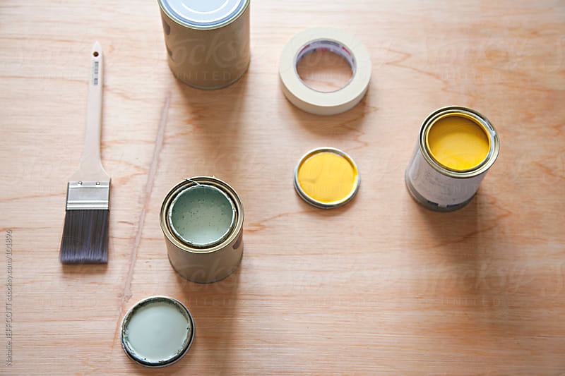 choosing and testing paint colours for bedroom in home. by Natalie JEFFCOTT for Stocksy United