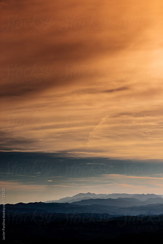 traces of planes in the sky sunset by Javier Pardina for Stocksy United