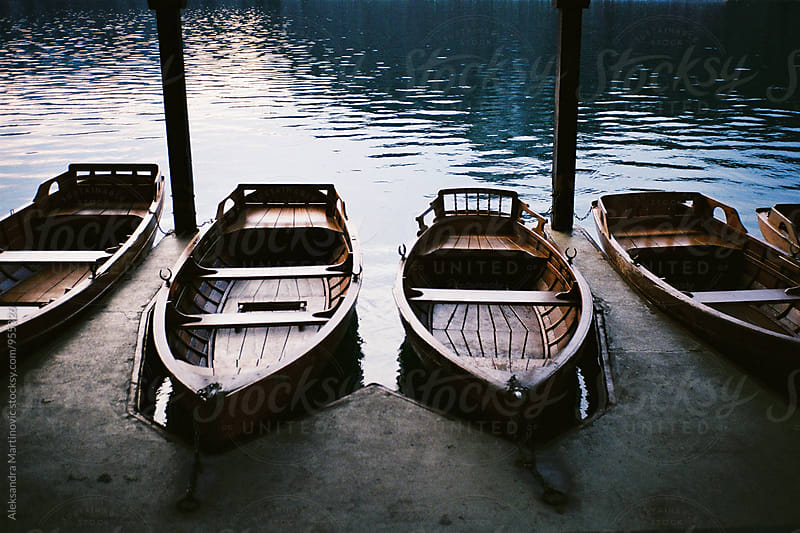 Wooden boats by Aleksandra Martinovic for Stocksy United