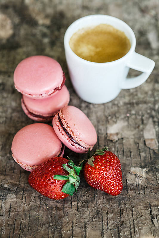 Strawberry macarons with coffee by Zocky for Stocksy United