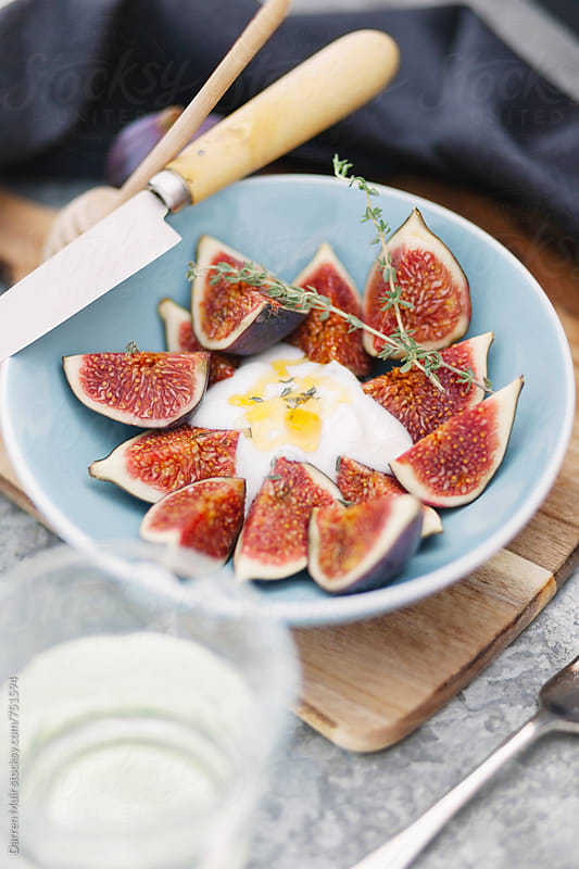 Figs and yogurt with honey and thyme. by Darren Muir for Stocksy United