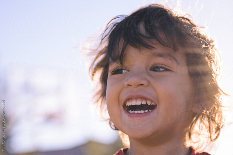 smiling happy laughing preschool boy by Tara Romasanta for Stocksy United