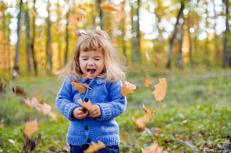 Little girl and autumn leaves by Sveta SH for Stocksy United