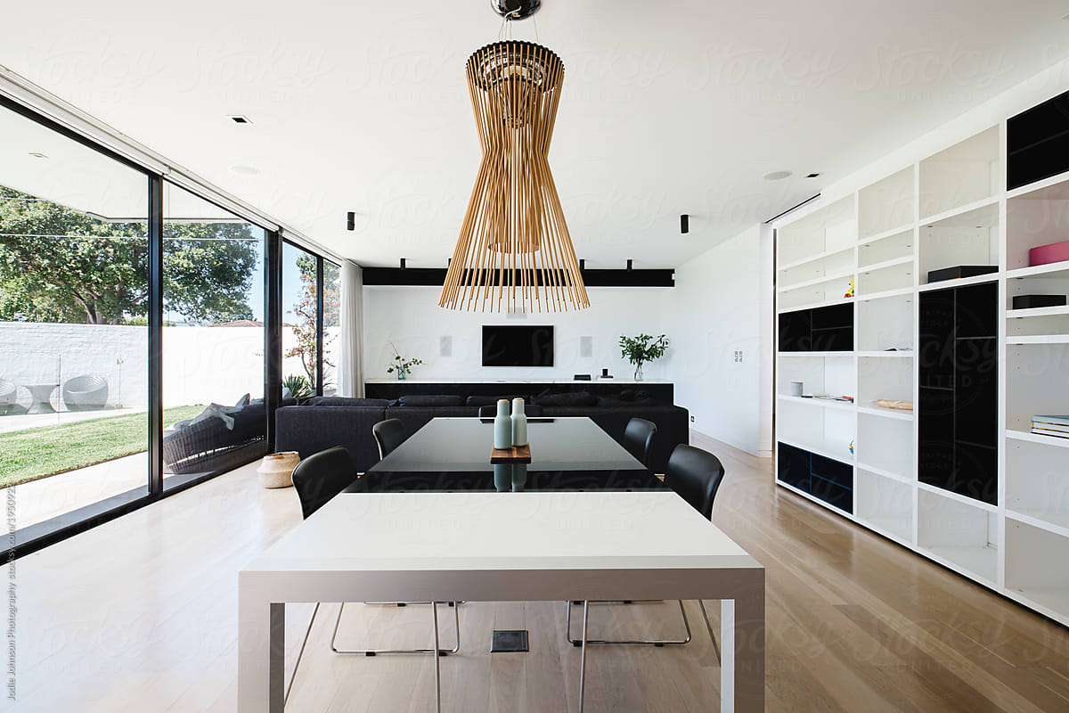 Open plan dining and living room with large glass sliding ...