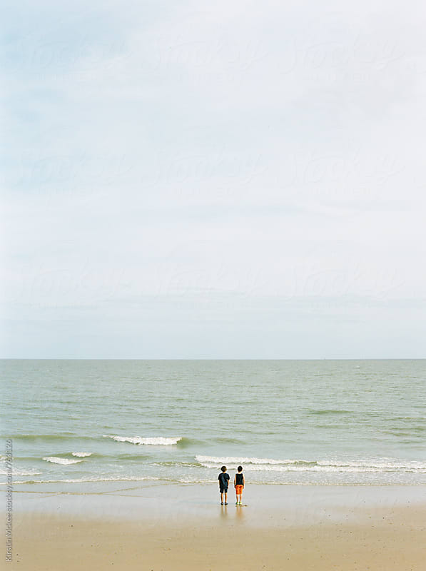 Two best friends at Frinton Beach, UK.  by Kirstin Mckee for Stocksy United