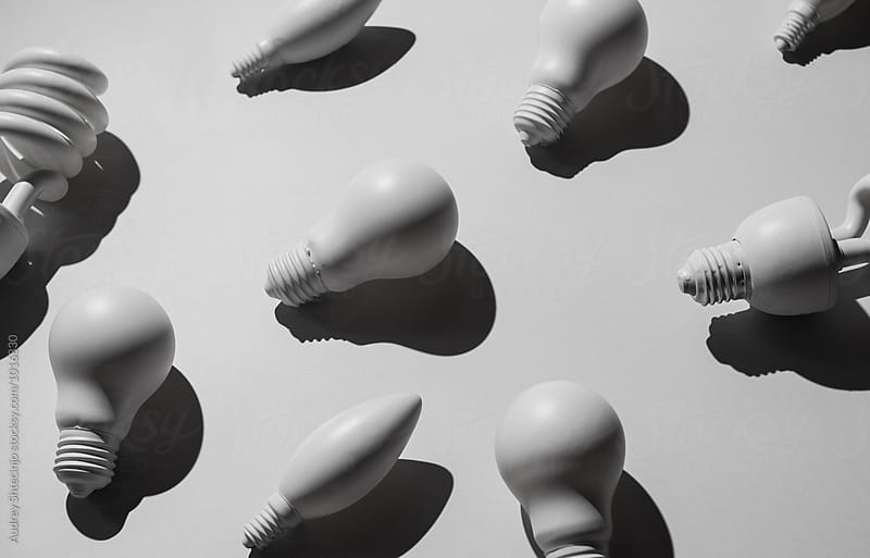 Various bulb lights  on white background  by Audrey Shtecinjo for Stocksy United