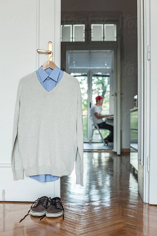 Male Clothes Hanging on the Door by Mosuno for Stocksy United