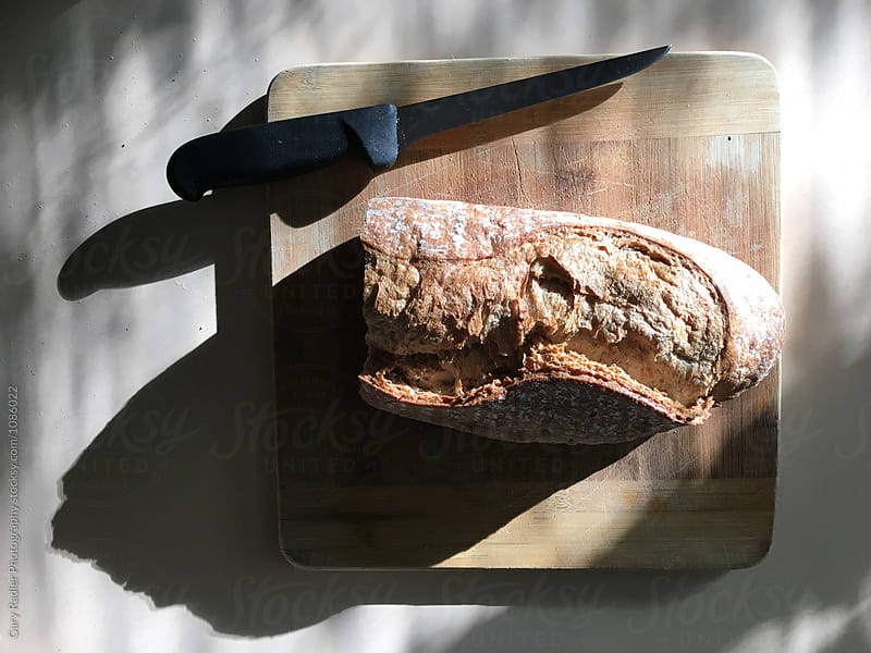 Sourdough Rye and Knife from Above by Gary Radler Photography for Stocksy United