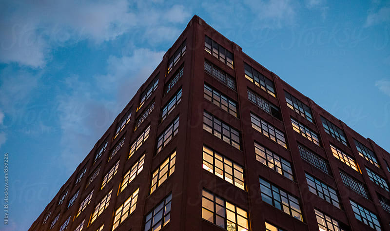 A warehouse type building at dusk. by Riley Joseph for Stocksy United