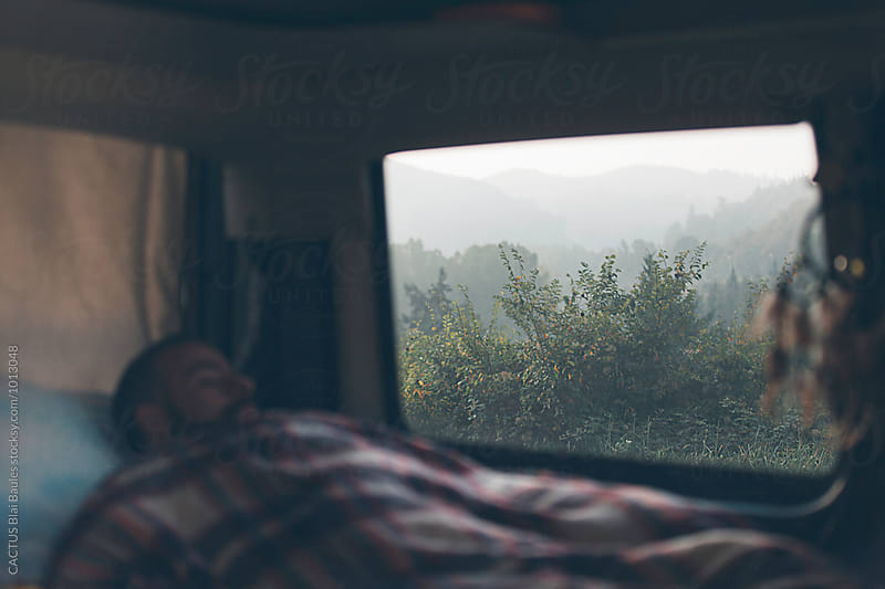 Sleeping in a camper van, mountain views from the window by CACTUS Blai Baules for Stocksy United