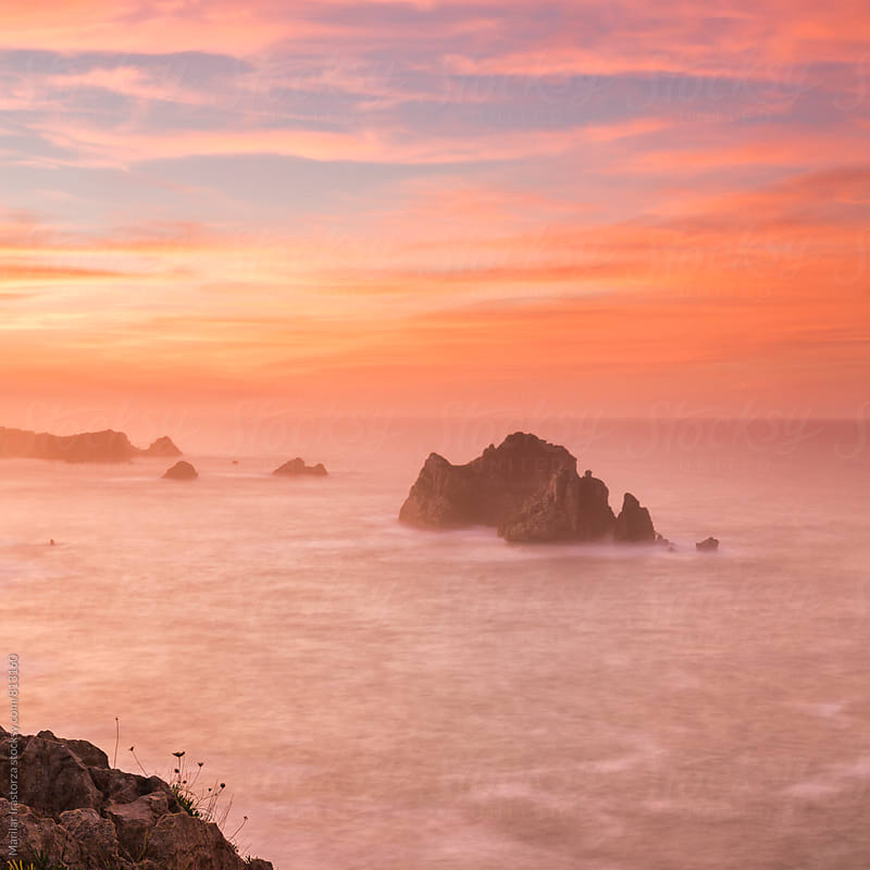 Misty coast in a spectacular sunset by Marilar Irastorza for Stocksy United
