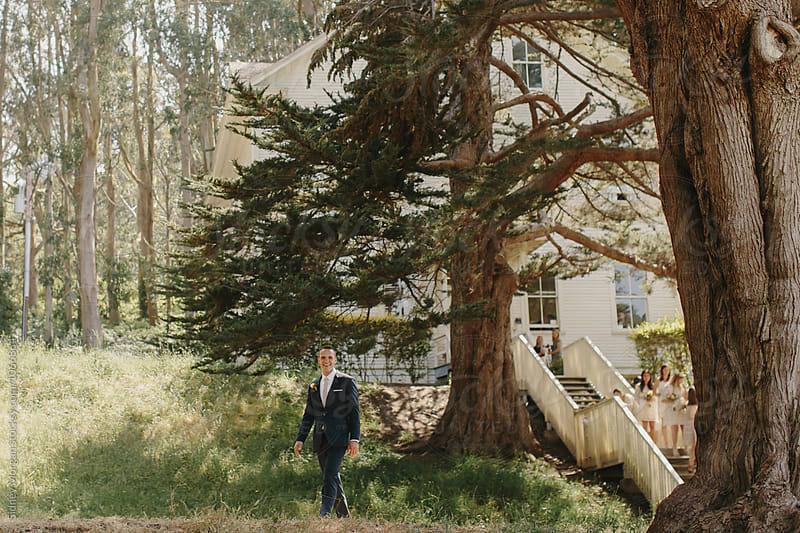 Groom Walking to Wedding Ceremony by Sidney Morgan for Stocksy United