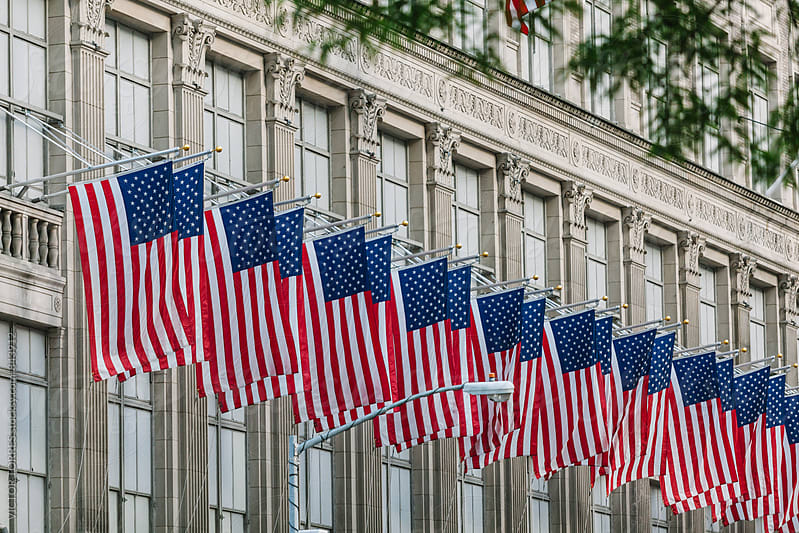 US Flags in a Manhattan Building by VICTOR TORRES for Stocksy United