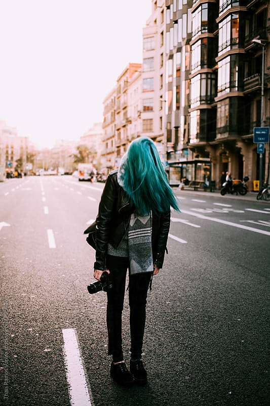 blue haired woman with a camera by Thais Ramos Varela for Stocksy United