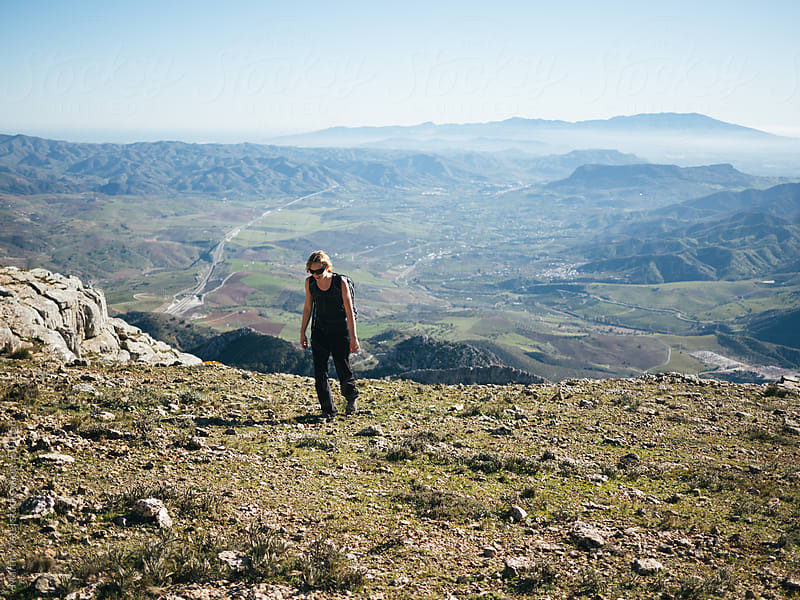 Girl got to the top of el chorro mountains by Martin Matej for Stocksy United