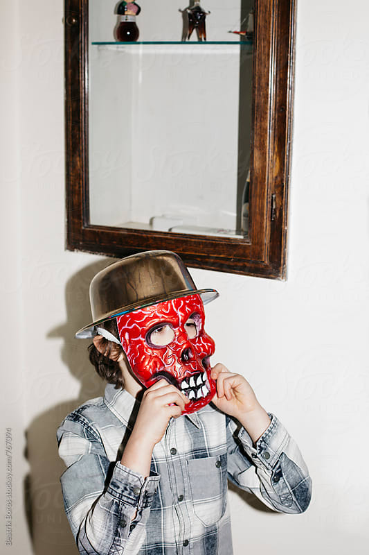 Boy wearing a scary mask by Beatrix Boros for Stocksy United