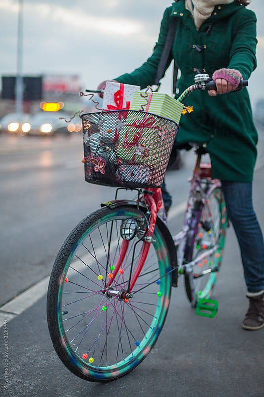 Carrying Christmas Gifts in a Bicycle Basket by Mosuno for Stocksy United