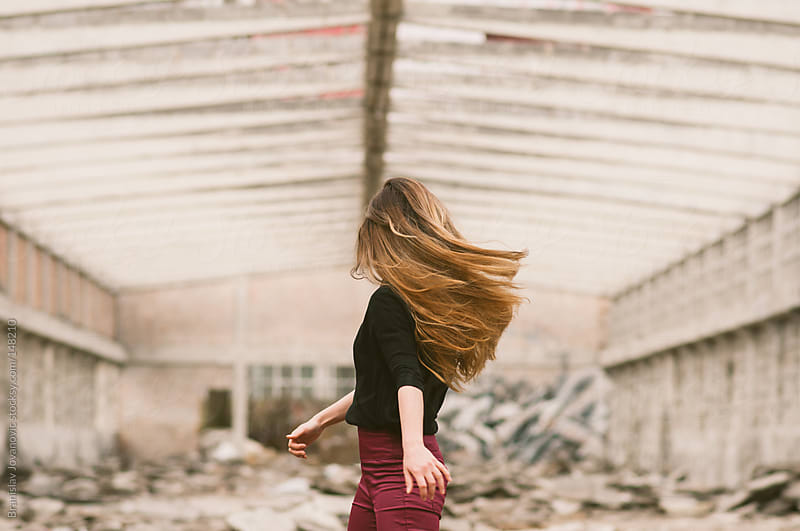 Young Woman Turns in an Abandoned Factory by Brkati Krokodil for Stocksy United