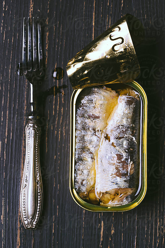 Sardines in a tin on table by Juri Pozzi for Stocksy United