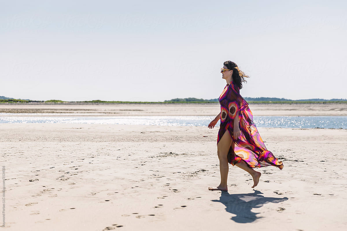 Beautiful Woman Walking On Beach With Colorful Dress by Raymond Forbes  Photography - Beach, Beauty