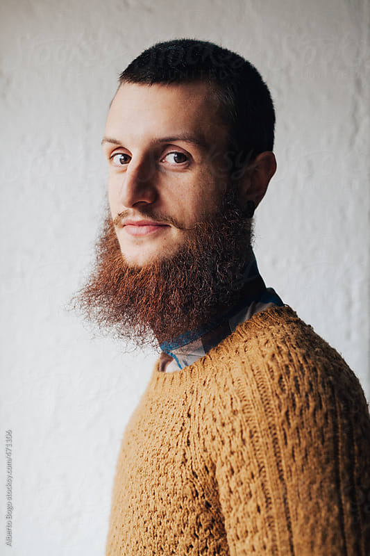 Portrait of Young man with long beard by Alberto Bogo for Stocksy United