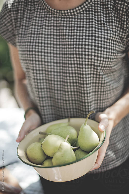 Fresh food: Woman carrying a dish with a organic pears  by Lydia Cazorla for Stocksy United