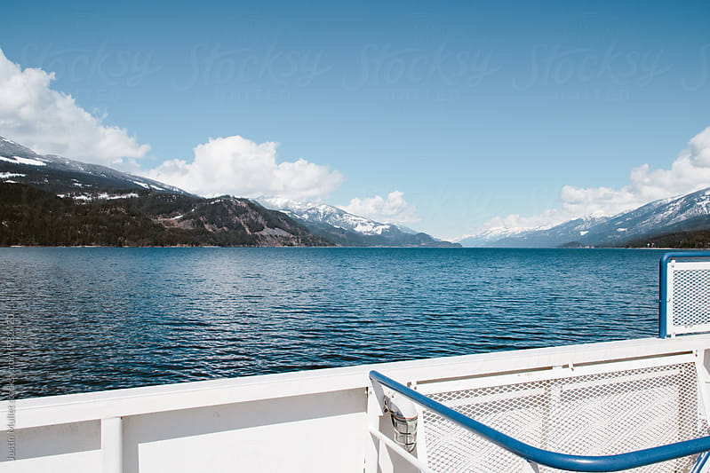 View of lake from a ferry boat by Justin Mullet for Stocksy United