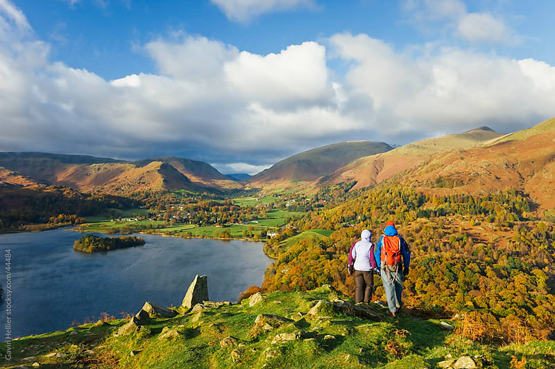 Walkers viewing Grasmere lake and village from Loughrigg Fell, Lake District National Park, Cumbria, UK by Gavin Hellier for Stocksy United