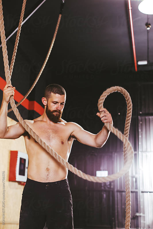 Portrait of a man with a climbing rope in a gym box. by BONNINSTUDIO for Stocksy United
