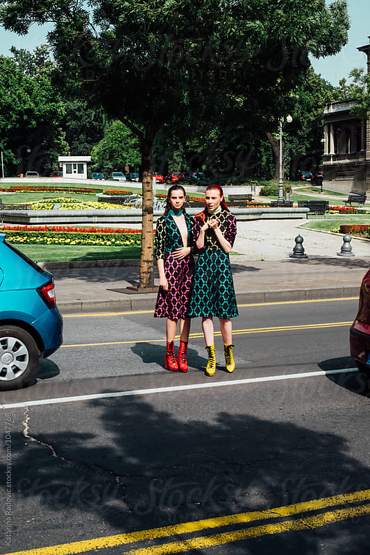 Two Fashion Models in Colourful Dresses  by Katarina Radovic for Stocksy United