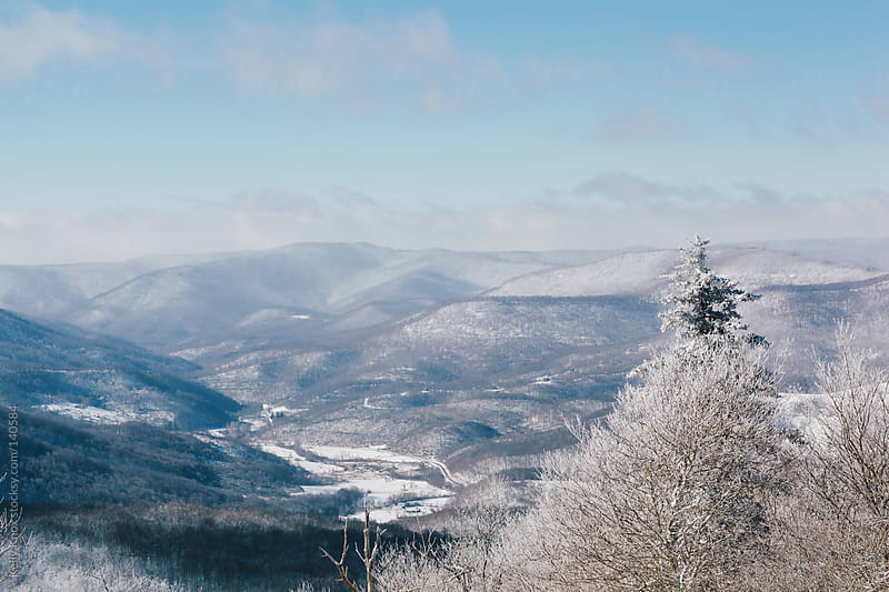 view of snow covered mountains by Kelly Knox for Stocksy United