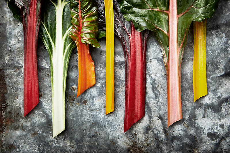 Rainbow chard on a metal worktop by James Ross for Stocksy United