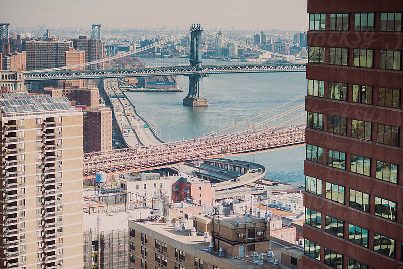 Cityscape of the east side of Manhattan (Brooklyn Bridge, East river) by Lauren Naefe for Stocksy United