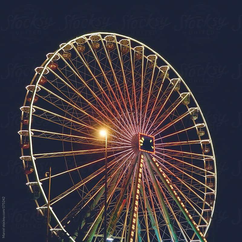 Ferris wheel at night by Marcel for Stocksy United