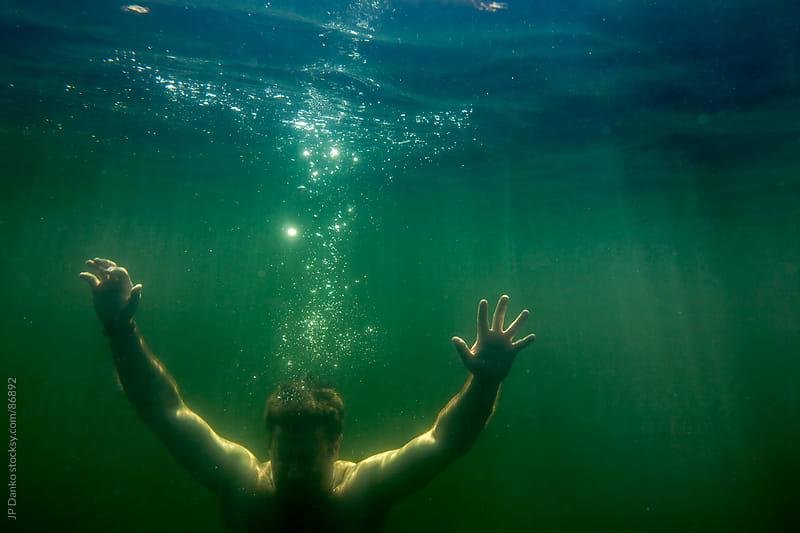 Man Sinking Underwater Like Depression by JP Danko for Stocksy United