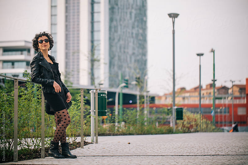 Young woman in the business district by Davide Illini for Stocksy United