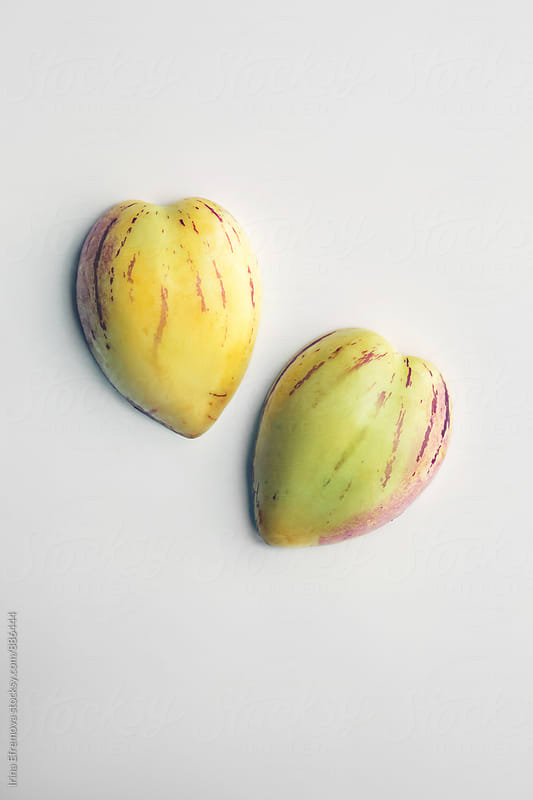 Two heart shaped sweet pepinos by Irina Efremova for Stocksy United