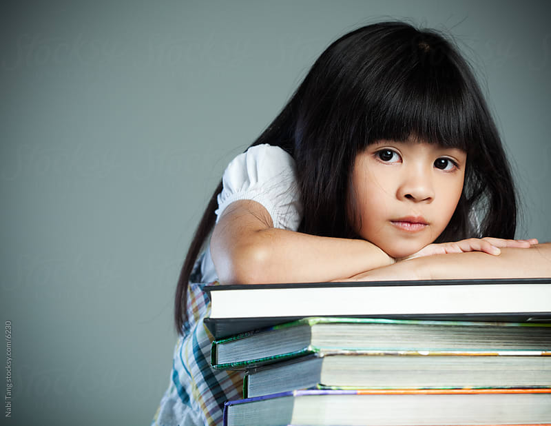 Little school girl with books by Nabi Tang for Stocksy United