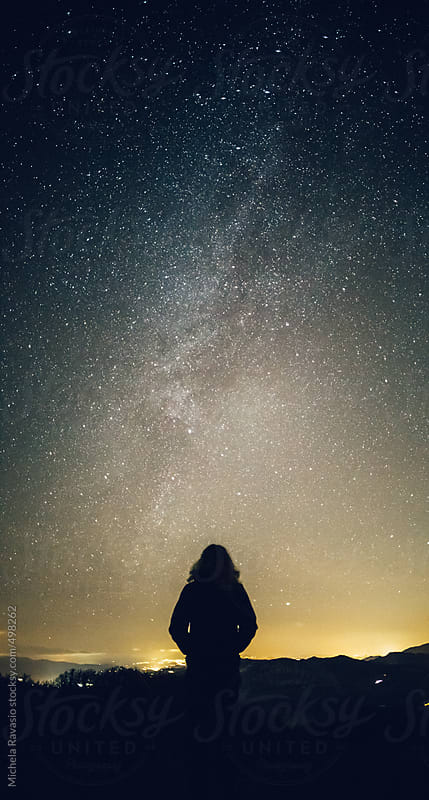 Woman looking at the milky way by michela ravasio for Stocksy United