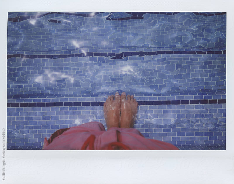 male legs on pool by Guille Faingold for Stocksy United