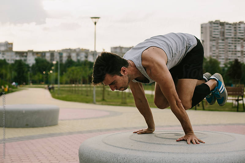 Young athletic man working out in urban environment