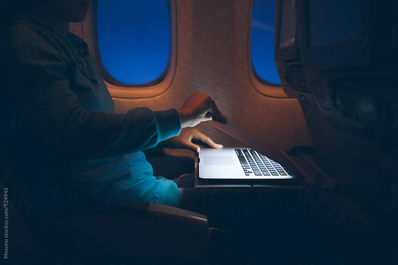 Anonymous Woman Using Technology On an Airplane by Mosuno for Stocksy United