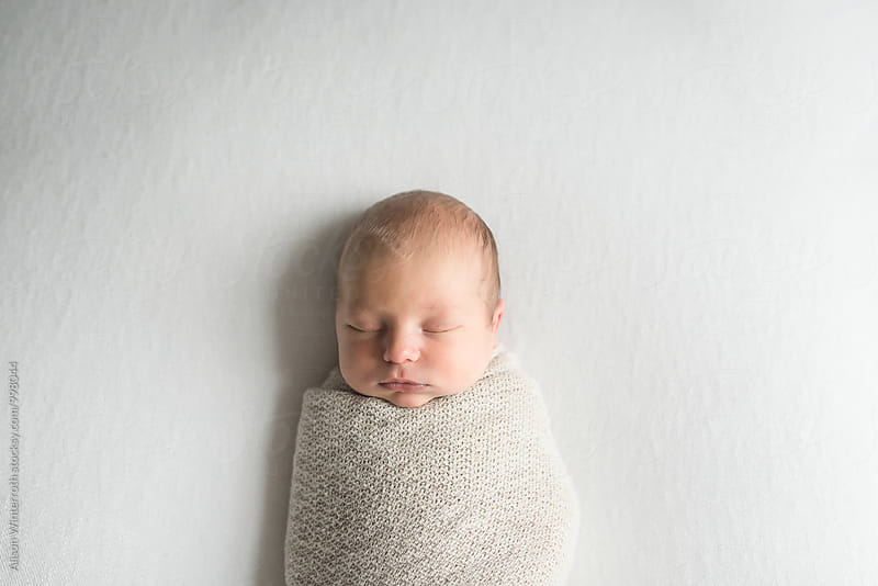 Swaddled Sleeping Baby by Alison Winterroth for Stocksy United