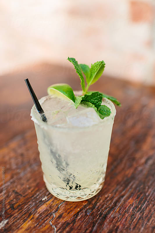A Mojito cocktails with mint & lime  by Kristen Curette Hines for Stocksy United