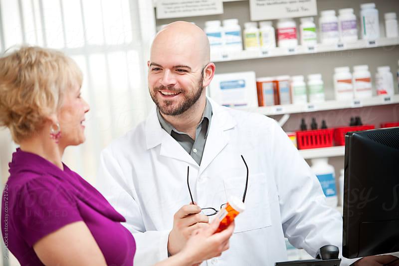 Pharmacy: Pharmacist Happy to Help Customer by Sean Locke for Stocksy United