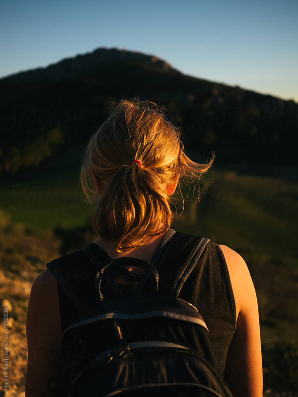 Girl hiking in el chorro mountains during sunset by Martin Matej for Stocksy United