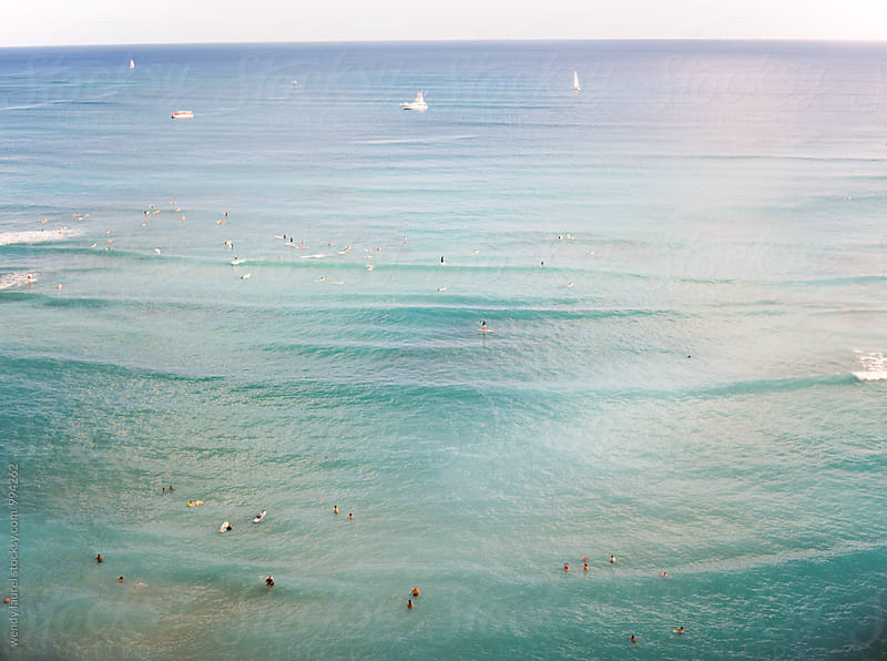 ocean shot of waikiki beach with surfers by wendy laurel for Stocksy United